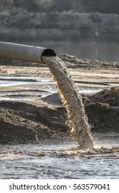industrial effluent, pipeline discharging liquid industrial waste into a river