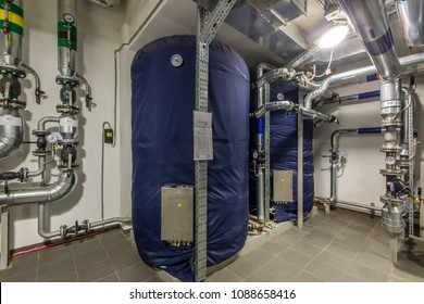 Industrial electric storage water heater. Modern independent heating system in boiler room