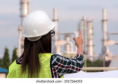 Industrial Engineer in a hard hat  at Oil-refinery and power plant site ,Industry ,Engineer and safety concept .