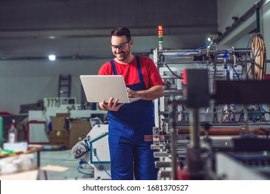 Industrial engineer with laptop in a  industrial manufacture factory working.