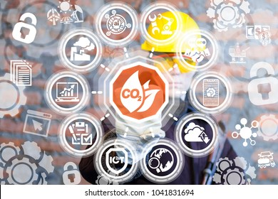 Industrial engineer presses co2 leaves button on a virtual interface. CO2 Leaf Ecology Smart Modern Industry Standard. Carbone Dioxide Industrial Emissions Eco Nature Safety concept.