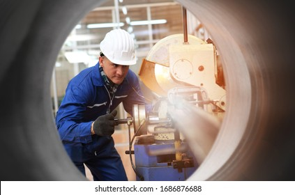 Industrial Engineers in Hard Hats  with  machine. Assist production engineer in industry. He checking or push metalwork control in industrial In a plastic factory for car. Concept Successful Of Work.