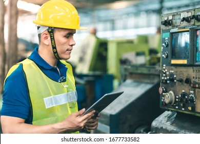 Industrial Engineers in Hard Hats.Work at the Heavy Industry Manufacturing Factory.industrial worker indoors in factory.Asian young man working in an industrial factory.