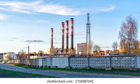industrial enterprises with pipes against the blue sky