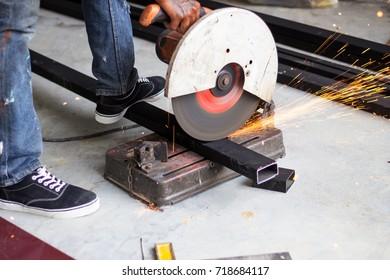 industrial equipment men working cutting metal