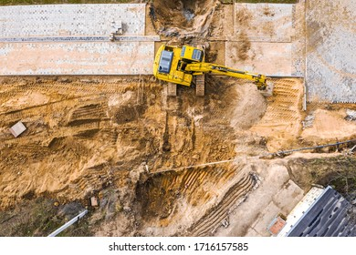 industrial excavator working on construction site. heavy construction machine. aerial view