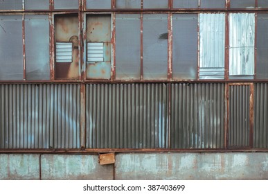 Industrial facility glass rusty wall texture background. Vintage effect.