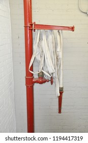 Industrial Facotry Firehose on Wall in Stairwell