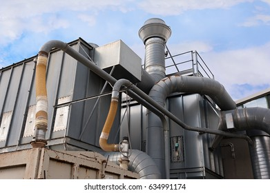 Industrial factory air filtration system. Tubes, tank and chimney.