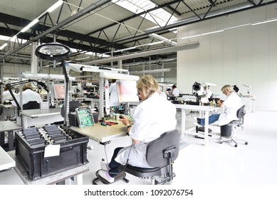 industrial factory for assembly of microelectronics - interior and group of female workers