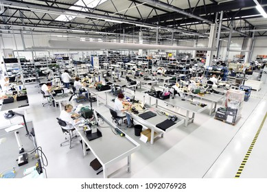 industrial factory for assembly of microelectronics - interior and workers
