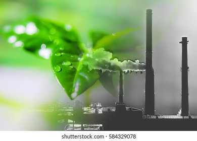 Industrial factory chimneys on background of green plants . The concept of relevance for the protection of nature