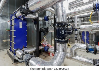 Industrial Factory equipment stainless tubes Food automation. Equipment, cables and piping as found inside of modern industrial power plant. Pipeline assembly. District heating substation. Moscow 2018
