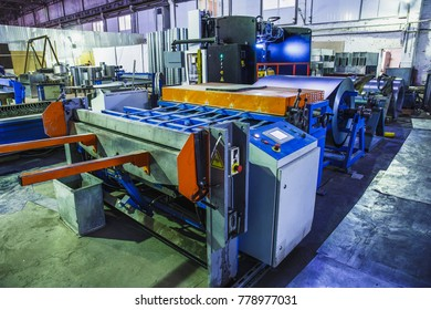 Industrial factory with equipment tools in large workshop or warehouse, manufacturing and steel works, industrial background