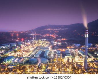 industrial factory with smokestacks and smoke at the night