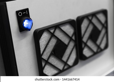 Industrial fan panel with blue on off switch, close up photo with soft selective focus