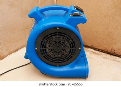 Industrial fan to remove water damage.