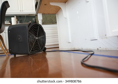 Industrial Fan for Water Damage in Kitchen