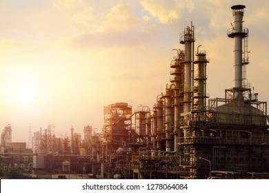 Industrial furnace cracked hydrocarbon in petrochemical business on sunset sky background, Manufacturing of petroleum industrial plant