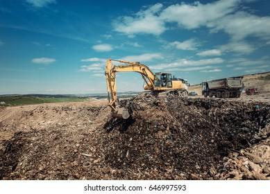 industrial garbage dumpsite - excavation works with heavy duty machinery