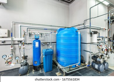industrial gas boiler water treatment system with storage tanks and multiple filters.