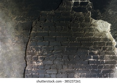 Industrial grunge background of black burned crumbling brick wall texture
