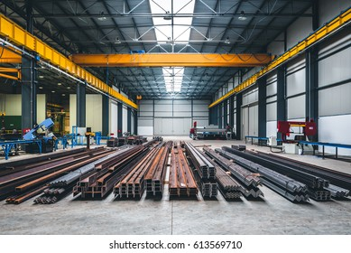 Industrial hall with cutting, welding machines and metal profiles