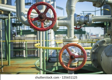 Industrial hand valve in petrochemical plant.