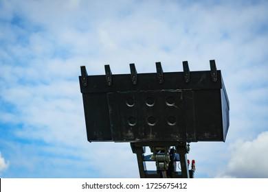 Industrial hay telehandler against sky. Telescopic handler. Agricultural machinery, farm equipment. Boom lift loader machine forklift.