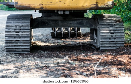 Industrial implement steel metal wheel tracks on dirt