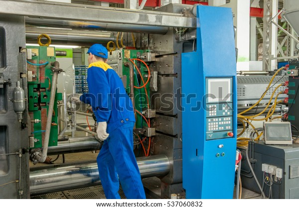 Industrial Injection Molding Press Machine Manufacture Stock Photo