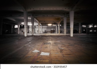 industrial interior of an abandoned factory building, poor light, color effect