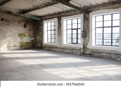Industrial interior with bright light coming through windows.