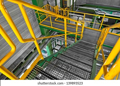 Industrial Interior with large colorful staircase