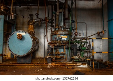 Industrial interior with storage tank in rusty colors