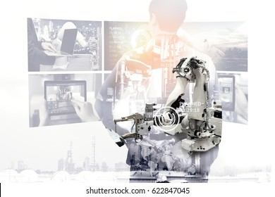Industrial internet of things , disruption technology and industry 4.0 concept. Double exposure of automate wireless Robot arm and business man monitoring digital display system in smart factory.