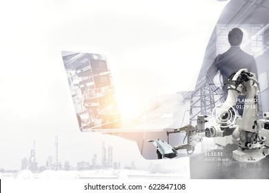 Industrial internet of things , disruption technology and industry 4.0 concept. Double exposure of automate wireless Robot arm and man using laptop for control and monitoring system in smart factory.