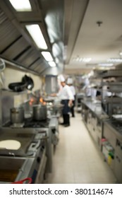 Industrial kitchen of a restaurant, hotel or hospital with busy cooks working.