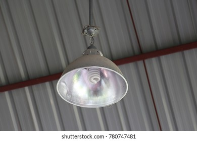 industrial lamp hanging on ceiling