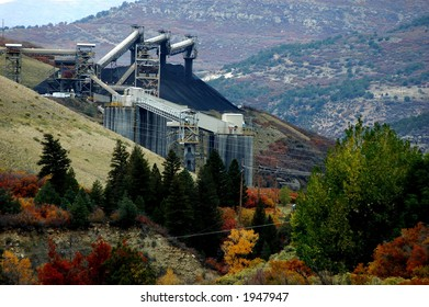 industrial landscape of coal mining infrastructure on side of hill in mountain country