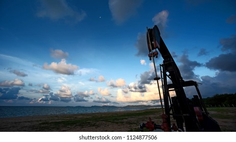 industrial landscape oil pumps backdrop of the sea on a bright morning.