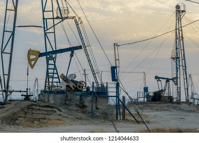 Industrial landscape, oil pumps and rigs extracting natural reserves