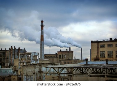 Industrial landscape with power plant and pollution smoke on the background