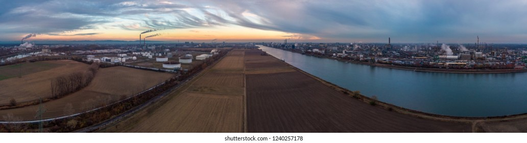 Industrial landscape with the river Rhine and chemical production plants at Mannheim and Ludwigshafen in Germany.