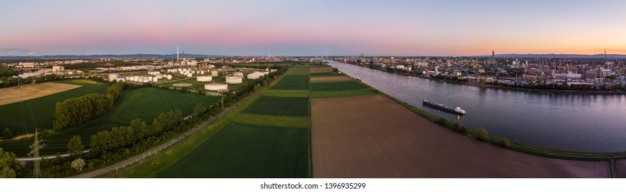 Industrial landscape with the river Rhine and chemical production plants at Ludwigshafen as seen from Mannheim in Germany.
