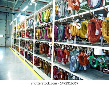 Industrial landscape with shelves of colored wire ropes at a modern plant for the production of wiring for automobiles. Logistics