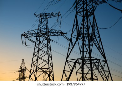 industrial landscape. Silhouette High voltage electric tower on sunset time and sky on sunset time background.