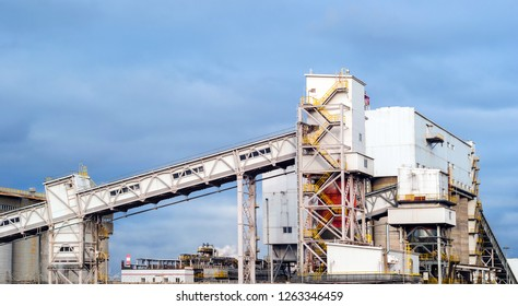 Industrial landscape - storage and loading hopper for loose materials with inclined conveyor galleries