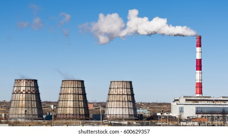 Industrial landscape. Thermal power plant with smoking chimneys. Horizontal rectangular photo.