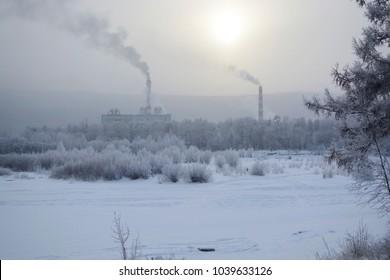Industrial landscape in winter near the river.
